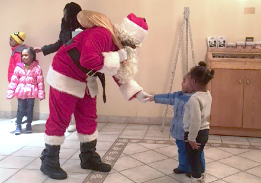 children greet with Santa Claus